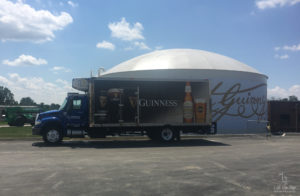 Delivery Truck in front of Guinness' signature at Guinness Open Gate Brewery and Barrel House